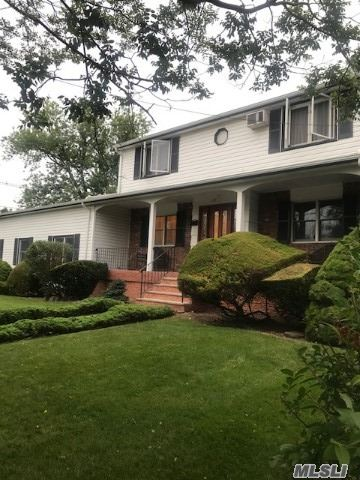 Beautiful 5 bedrooms, 4 bath Colonial,  perfect for large Family, with 2 att car garage and a driveway for 6 cars, large kitchen has radiant heat floors, beautiful patio and deck , large living room with fire place, formal dining, porch in front, large den. Inground lawn sprinkles,