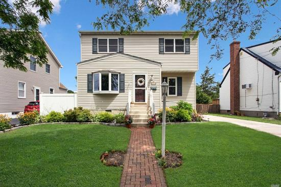 Welcome to Mandalay. This inviting colonial has an open floor plan, a three season sun room overlooking a good size yard, updated baths and kitchen. The living room has a gas fireplace and the dining room is large enough for the whole family to gather. All the bedrooms are spacious. The finished basement is beautifully finished. Live like a local in Wantagh where you have beaches, restaurants, and desirable Wantagh schools.