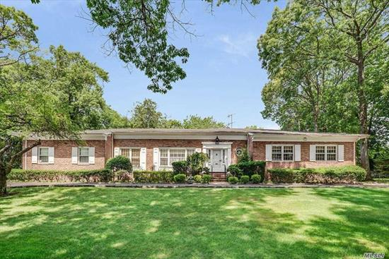 Elegant all brick ranch with spacious rooms overlooking 1 lush acre with gorgeous in ground pool, luxurious master bedroom suite with fireplace and dressing room, huge kosher eik with granite countertops, full finished basement, prime back Lawrence location. taxes to be reduced in September