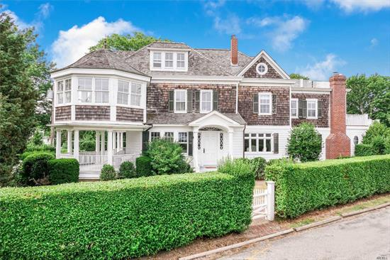 Known locally as the Tea Box this quintessential, historic Bellport Village home provides spectacular water views of Bellport Bay, Fire Is. & Atlantic Ocean! This stately home features large, bright rooms w/ the perfect mixture of old world charm and updated amenities! Open gourmet kitchen looks through the quaint screened porch onto your 50X20 gunite pool with blue stone patio! With 5 bdrms/4.5 baths you and your guests will have plenty of room to enjoy all that luxury living has to offer.