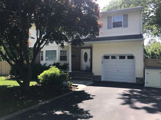 Bright, welcoming home located on Cul De Sac in Harborfields School District. Shy Half Acre, Private Property with Deck and Brick Patio. All Season Room with Air and Heat! Gleaming wood Floors Spacious Rooms.