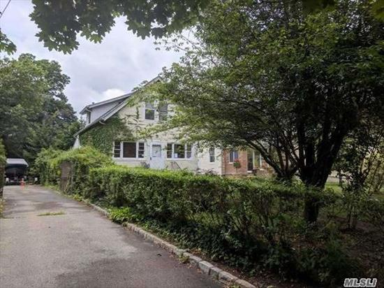 Cozy Colonial Featuring Spacious Rooms, An Enclosed Porch, Hard Wood Floors, A Detached Garage, And A Full Basement For Storage! Close To Loffs Lake, Silver Lake Park, And The Baldwin Train Station For An Easy Commute Or Day Trip To Manhattan! Come Make This Your Dream Home!