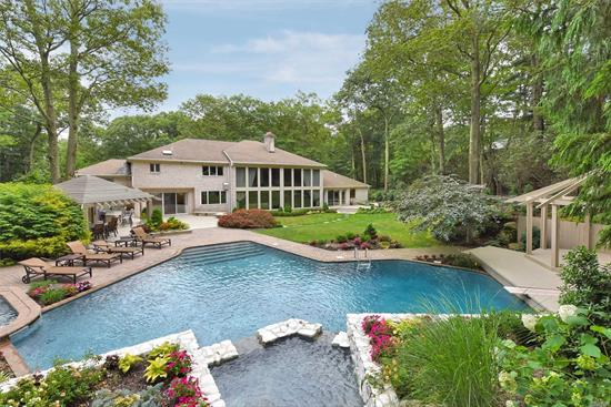 Impressive recently updated brick colonial on 2 majestic acres, elegant interiors and a showcase backyard setting in the Tall Oaks Private Community of Oyster Bay Cove. Salt water pool, new heater, hot tub, expansive deck, covered seating, outdoor bbq, plenty of entertaining space. Master suite on the main level. Renovations include brand new kitchen, top appliances, new bathrooms and more. Separate 2-room suite ideal for guests. Low property taxes. Cold Spring Harbor Schools. Near Syosset LIRR.