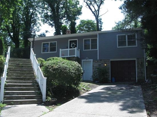 Steps to Beach! Like New!This Diamond Raised Ranch Has Upgrades That Include , New Quartz Kitchen, Stainless Appliances, New Washer Dryer , Wood Flooring , New Windows, Siding, Burner, New 200 Amp Elect, Smart Features, Full Finished Basement with OSE .