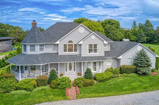 Winter waterviews and a short distance to Orient Village in a quiet seaside Estate enclave, this thoughtfully built home offers relaxed living space w/open kitchen, dining and living area w/large wood burning fireplace and is perfect for entertaining. There are 4 bedrooms and 3 baths. The master bedroom with fireplace and en suite bath w/sep shower & spa tub. Sep laundry room, Large basement and 2 c/garage with high ceilings. All set upon a beautifully landscaped 1 acre w/100 ft of Deeded Beach