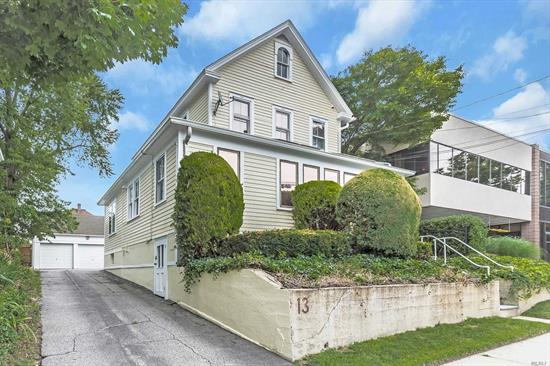 Directly across from LIRR, incredible visibility & locations, mixed use building, alarm, newly painted iside & out, fire retardant, 2 garages, plus 4/5 parking spots for extra income.