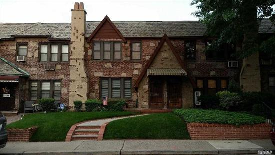 This beautiful 1-family 20'-wide brick Tudor home features a front porch, private backyard with patio, detached 2-car garage, breakfast nook in kitchen, formal dining room, three (3) bedrooms, full bath with tub & shower, full and finished basement, decorative fireplace in living room, original craftex walls on first floor, terrazzo tiled floor in basement, original woodwork & doors, parquet floors throughout the house, and a convenient location close to shopping, transportation & restaurants!