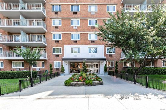Updated spacious apartment offering 2 Bedrooms, 2 Bathrooms and a terrace with open views. Walk in closet. Corner unit offering cross ventilation and modernized kitchen. In zone for private Sunnyside Gardens park. Proximate to shopping and eateries of Skillman Avenue.