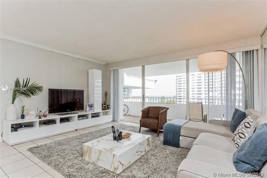 Great Opportunity To Own This 2/2 Ocean View Unit In Most Desirable Commodore Club East. Updated Unit With Den Making It A 3 Bedroom Unit. Tile Floors Throughout. Crown Molding And Wood Shutters And Blinds. Washer And Dryer Inside The Unit.