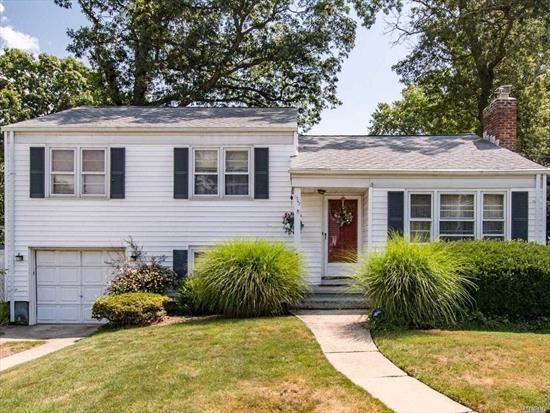 Beautiful 3 Bedroom, 1 1/2 bath Split situated on a beautiful block in the heart of Wantagh, Features Master w/ 1/2 Bath, Formal Dining Room, Spacious Living Room, Eat in Kitchen, Family Room w/door leading to a Beautiful Manicured Backyard. New Tax Assessment Start 2020/2021 tax year $13, 426, Reduction of $4, 347