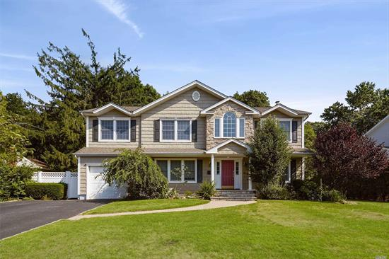 Gorgeous Colonial On Oversized Property Located On Beautiful Tree Lined Street In Desirable Syosset School District. Entire House Rebuilt in 1994. 5 Bedrooms, 4 Full Baths, Eat In Kitchen, Formal Dining Room, Living Room, Full Finished Basement w/ Lots of Storage Space, This Home Has All Of The Amenities With Many Updates. Enjoy The Lower Level Entertainment Area, Sauna, Parklike Grounds. Walk To Shopping and Lirr. Won't Last!!!