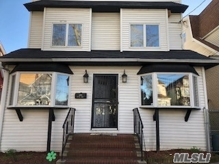 Beautiful updated Spacious 5 Bedroom 2 Bath Colonial offers Eat-In-Kitchen, Dining Room, Living Room, Den, Full Finished Basement with Out Side Entrance, oversized Yard, Private Driveway, close to all shopping and transportation and plenty of room for mom.