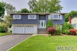Wideline Hi-Ranch on Cul-de-Sac Features All Large Rooms! Updated Windows, King MBR en Suite, Central Air Conditioning, Oak Floors, New Boiler, In Ground Sprinklers in Oversized Yard and More! Many Possibilities with this Size Home! Convenient to LIRR, Parkway, Seaford Oyster Bay Expressway, Bethpage Park & Town!