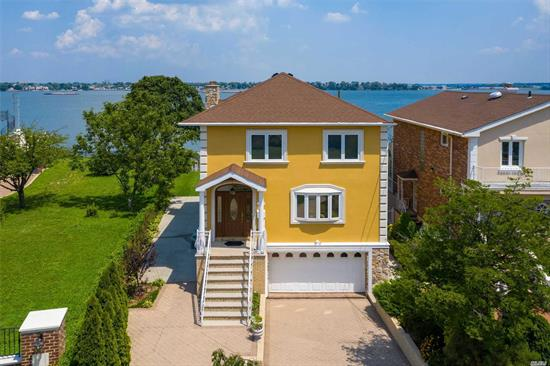 A Rare Gem! All Rear Rooms have Panoramic Waterviews!Fully Rebuilt in 2000.This Detached Colonial Is Nestled Between 2 Bridges with 61 feet of Waterfront!The 1st Flr Offers a LR, FDR, Full Bath Plus Huge Eik w/ Center Isle and a 450 Sqft Balcony.The 2nd Flr has 4 Bedrooms & 2 Full Baths.True Walk In Basement (1, 300 Sqft) with a Huge Family Room, Office, 1/2 Bath Sliders to Patio.Granite Counters, Stainless Steel Appliances, 5 Zone Gas Heat, 2 Zone CAC.Riparian Rights.Vacation Living All Year Round!!