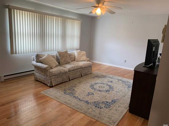 Spacious, Bright and Sparkling Clean 1 Bedroom, 1 Bath Condo. New Hardwood Floors & Moldings, Fresh Paint, 2 AC Wall Units, 5 Closets, Front-load W/D, Reserved Parking
