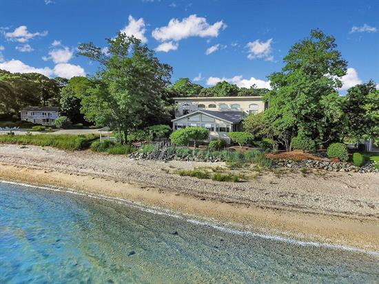 Southold Bayfront - Bright 5 BR, 4.5 BA contemporary. Spacious open floor plan for family gatherings and entertaining. Great Room with vaulted ceiling leads to four season waterside porch with sweeping water views over Southold Bay to Shelter Island. Four generous en-suite bedrooms; two have waterside terraces. Protected beach with no bluff. Enjoy carefree & barefoot summers here!