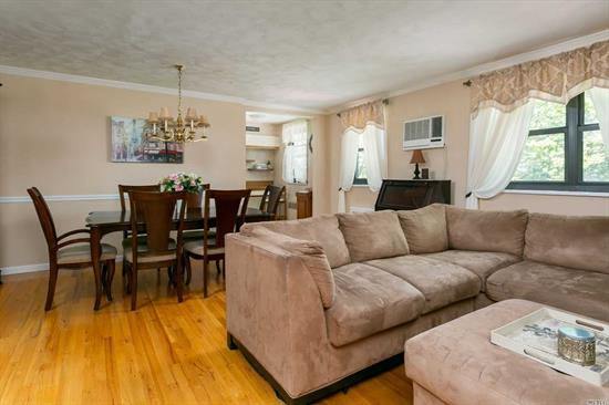 Beautiful, turn key ready 2 Bedroom upper unit with large stand-up finished attic / New Washer & Dryer/dishwasher / Office area / hardwood floors/ large closets/ Maintenance includes everything Gas, electric, Heat, Water & Taxes. Amazing area close to all Express bus to NYC & Flushing. Q16, Q76, QM20. PS 209.