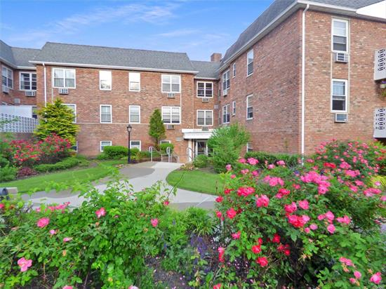 Commuters Dream. Enjoy coffee on your own private terrace or take a dip in the pool. This large, bright 1 Bedroom unit features a galley kitchen, extra large living room, dining room, updated designer full bath, and an outdoor terrace. Lots of closets. 24/7 Laundry on premises. Walk to Lynbrook LIRR station, Atlantic Ave shopping, great restaurants, and beautiful new movie theater. $50 for outdoor parking space, but you barely need a car. Move right in.