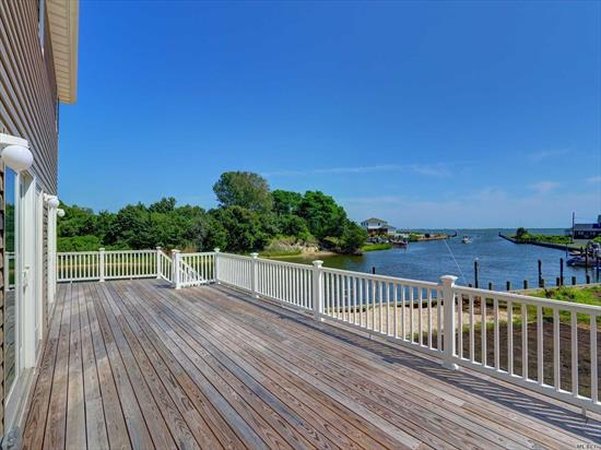Stunning views and breathtaking sunsets of Moriches Bay and Fire Island. This property has a large sun deck and 108 feet of bulk head on Orchard Neck Creek - The tastefully re-done home offers 3 bedrooms, living room, dining room, laundry room, 2.5 bathrooms, hardwood floors throughout. 2 zone CAC, 2 zone heating, additional storage room and utility room.   Bring your boat, this property is a MUST see!  *Taxes TBD by Brookhaven Town