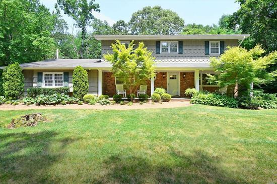 Decorator's delight in North Dix Hills! Beautifully appointed home features rich wood floors, distinctive moldings, custom built ins & designer details throughout. Light & bright kitchen with commercial grade cooking. Many updates include brand new gas heating system, closet systems, LED lights, new & updated baths, some new windows.This move in ready home is privately situated on North Dix Hills acre. Low taxes. Vanderbilt Elementary School.