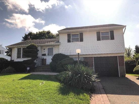 Expanded Split Level home in Syosset Groves! 3 Bedrooms, 1 and a half baths. Oversized kitchen opening out to a beautiful new cedar deck. South Grove Elementary, H. B. Thompson Middle School, Syosset High School! A Must See! Will Not Last!