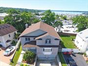 Well maintained center hall colonial features open floor concept, offers 4 Brs includes master suite/dressing Rm/Jacuzzi/Balcony. High ceiling and hardwood floor/marble Flooring throughout. Modern eat-in-kitchen w/granite counter-top/center island, opens to over-sized Den w/fireplace and access to the deck with waterview. Full finished basement with sliding doors to the private backyard. Ideally location, close to all.