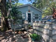 NEW TO MARKET!! Charming 2 Bedroom Cottage Accented with Front Deck perfect for the Summer BBQ. This cottage is in desirable beachfront, seasonal community of Woodcliff Park. Season is open April 15-October 15. Features Living Rm Open to Eik, Full Bath w/Tub, 2 Bedrooms both with Bunk beds, outdoor shed, & private driveway. Land is leased annually. Cash Sales Only!!