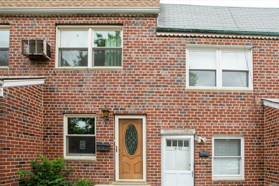 Commuters delight! Ideal solid brick legal two family attached town home blocks to  Bayside village Bell blvd LIRR, culturally enriched dining and entertainment, shopping, Northern Blvd and major highways. This home offers a renovated two bedroom apartment with updated cabinetry and stainless steel appliances, Washer dryer and private balcony on the second level. First level apartment features an eat in kitchen, spacious living room facing rear patio, one bedroom and a full bath & garage