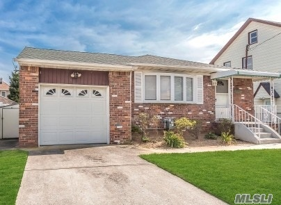 brick ranch, mid-block location, totally fenced in yard, garage, hardwood floors through out, stand-by generator, stainless steel appliances, brand new amazing bathroom, updated windows, freshly painted