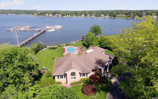 Waterfront Living With Extraordinary Panoramic Views! This Sundrenched Contemporary with Oversized Rooms Features an Open Floor Plan Boasting High Ceilings and Wood Floors Throughout. This 100, 000 Sq Ft Property Offers Stunning Views. Relax By the Heated Pool and Patios While Enjoying Breathtaking Views of the Long Island Sound and Manhasset Bay.This Custom Home is Perfect for Elegant Entertaining and Casual Living Year Round.