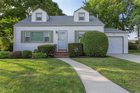 Charming 4 Bedroom, 2 Bath Cape In Arnold Estates. The Home Boasts Hardwood Floors, 1 Car Garage With Additional Storage, Partially Finished Basement, Updated Roof, Windows & Siding All Situated On A 70x100 Lot. THIS ONE TRULY WILL NOT LAST!