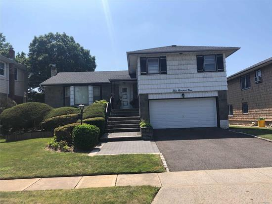Spacious 3BR Home On A Quiet Tree Lined Residential Street, Features Central Air Conditioning, High Hats, Eik W/SS Appliances, IGS, 200 Amp Service, 2 Car Garage, Finished Basement, New Front Steps.