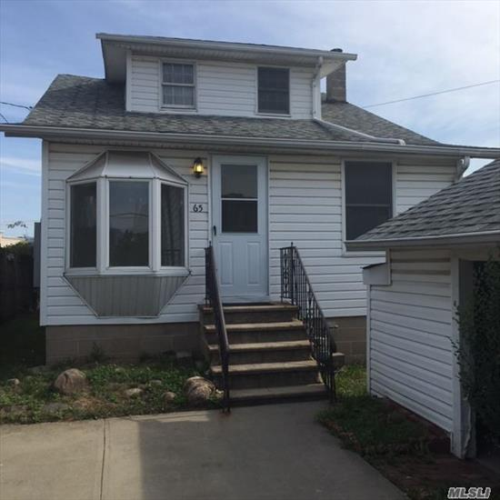 House is in nice condition, upstairs needs work, Bulkhead is in need of repair, AE flood zone, Garage needs repair, great water location. House much larger than it appears.