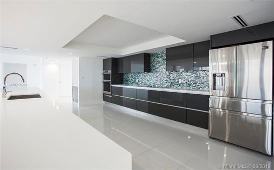 Spectacular Miami Views!! 2 High-Rise Condo Units Legally Combined & Remodeled To Make An Ultra-Modern Open Concept 2-Bedroom, 2.5 Bath Luxury Residence. Featuring 2 Huge Masters, New Bathrooms, Open Concept Kitchen W/Top Of Line Appliances, Quartz Counter Tops & Huge Kitchen Island! Modern European Style Cabinets W/Porcelain Floors Throughout And Laundry Room W/ Hookups. Change Your Lighting, Temperature & Surround Sound System W The Crestron Smart Home System & 7 Digital Pad Display Controller! Melt Into The Panoramic Views On The Wrap Around Balcony Overseeing Biscayne Bay & Miami Beach! The Grand Is A Full-Service Pet Friendly Building W/24Hr Security, Pool, Gym, Salon, Spa, Dining & Access To Sea Isle Marina. Located Blocks Away From The Adrianne Arsht Center & Metro-Mover Station.