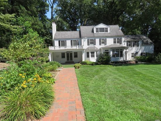 The best of all seasons are is found in this classic Colonial nestled on 2 private professionally manicured acres. Swim in the pool, relax in the hot tub or entertain on one of the many patios; cozy up in front of one of the fireplaces, and explore nearby Shu Swamp Preserve or Japanese Stroll Garden. Enjoy the many shops and restaurants in the quaint village of Locust Valley. Near private and public schools. See attached list of additional info and amenities.