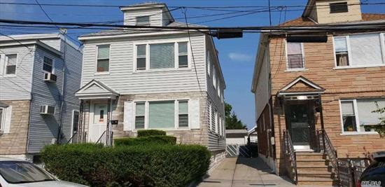 Prime location, close to Flushing downtown; Sizable two family detached, 55 over full basement; easily converted into 3BR; private driveway and garage; full half finished basement with side and back exit.