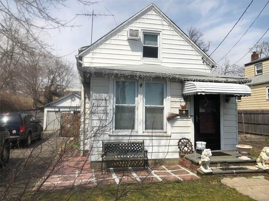 2 BR, 1.5 ba bungalow in Hewlitt. Home needs some updating throughout. Great investment opportunity, just needs some tlc.