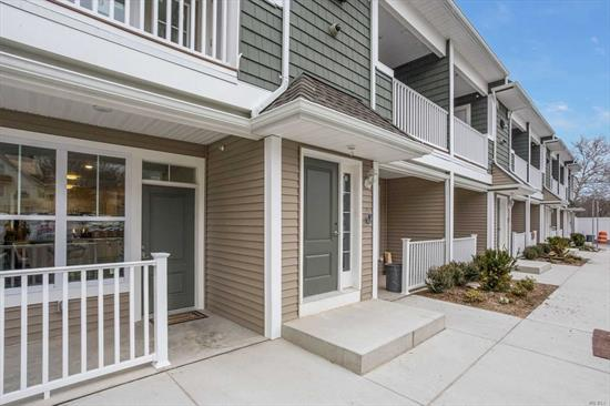 New Spacious One Bedroom Apartments. Designer Eik W/SS Appliances- Gas Cooking. Wood Design Flooring, Large Closets, CAC, Washer/Dryer, Balcony Or Private Porch Per Unit, Conveniently Located. A Must See!