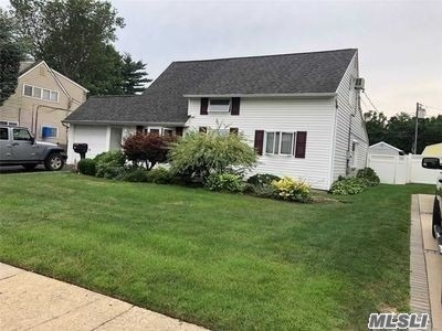 Beautiful Home in East Meadow Sd#3 Granite Kitchen , Wood Floors, Boiler moved , Separate Laundry rm behind Garage, Large Extension across Back, Fireplace Chimney removed, All Offers In Writing with Credit approval
