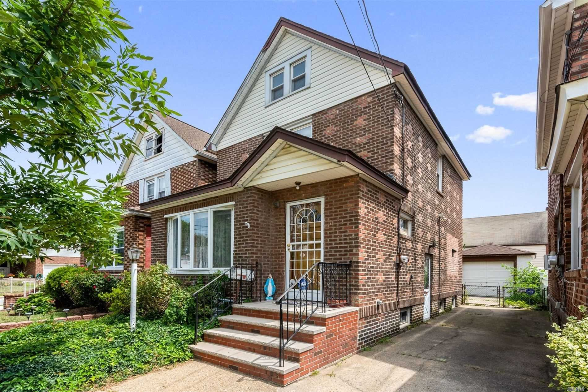 Beautiful Brick Colonial. This home features living room, formal dining room. Eat in kitchen. 3 bedrooms, 1 full bathroom, Full finished basement. Gas heat and hot water heater. One car Garage with a driveway . Close to public transportation and shoping.