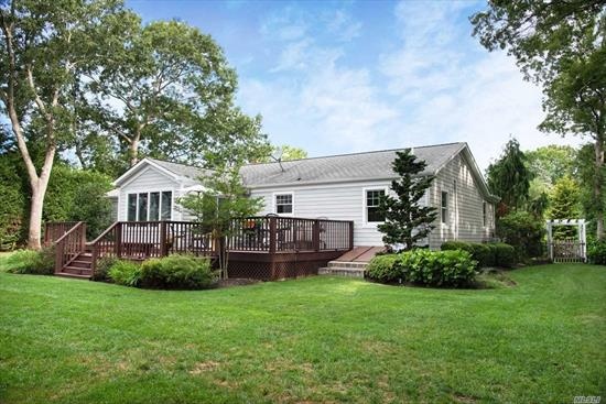 A pristine home that truly is turn-key, impeccable and meticulously maintained. This 3 Bedroom 2 bath, open floor plan ranch with custom kitchen, millwork, hardwood floors, a full basement and super clean, epoxy garage floor. The lush, mature landscape and large rear deck offer as a tranquil and idyllic setting.