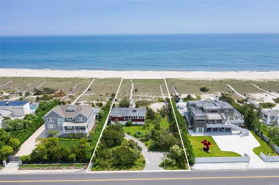 In one of the most desirable locations on all of Dune Road, this sun-filled beach cottage on almost an acre of land offers a sizeable 100 feet of ocean frontage, and an easement to Quantuck Bay. Enjoy both bayfront and oceanfront vistas from almost every window, and of course, the relaxing upper deck.  Upon entering this split-level cottage, you'll find an inviting family room with picturesque beach views from the large window and a wood-burning fireplace. You'll also enjoy bay view