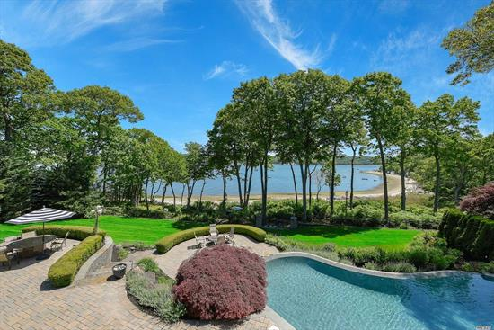 Breathtaking 6000sqft waterfront home situated on meticulously landscaped grounds w/ 220ft of beachfront. It Features 5 Bedrooms, 4.5 Baths, Formal Dining, Living Room, Den, & Great Room. Enjoy sunrise & sunsets from a custom 4-Season Sun room or tiered patio surrounding a multi-level Gunite Infinity pool. Guests will love the fully equipped Pool house, Custom Home Theatre, Internal/External Sound System, & Game Room w/ Full Wet Bar. Vacation at home with this true piece of paradise.