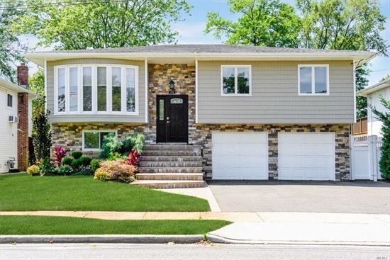 Must see this move in ready high ranch. Some Updates include, Roof, Stone and siding exterior, windows, boiler, AC, and bathrooms.. Master bedroom with bath, den with sliders to oversized backyard , 2 car garage and more. Don't miss out..