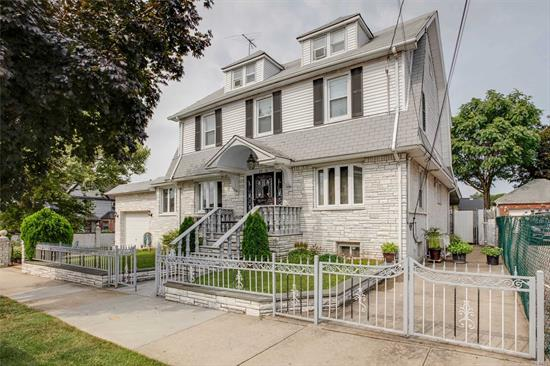 Gorgeous Center Hall Colonial in Prime Whitestone. The First Floor Offers a LR with FPL, FDR, EIK, DInette, and a 1/2 Bath. The 2nd Floor Has 3 Bedrooms 2 Full Baths Plus a Finished Walk Up Attic with Another Bedroom and Full Bath. Fully Finished Basement With Family Room, Wet Bar, Sauna, Media Room, 1/2 Bath Plus Closets Galore. 6 Unit Split System CAC, Attached 1 Car Garage with 2 Private Driveways. Huge Sun-Soaked Yard with Pavers and Patio. Near Schools Shops and Transportation.
