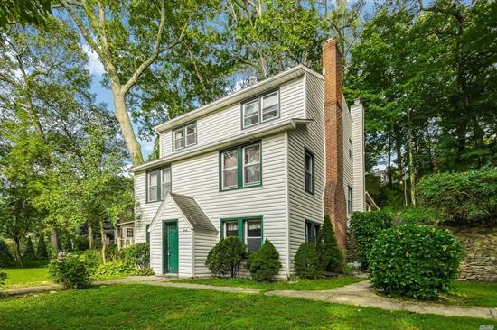 Large home w/LOW taxes! Kit w/dining area, stone fpl & wood floors under carpet. Legal Acc Apt on 3rd floor has large kit and living room area, br, bath, plenty of closets. 2 car det garage w/extra storage. Updated siding. Perfect mother/daughter. Harborfields SD, centrally located between Northport & Huntington. Home needs work & updates, Sold As Is.