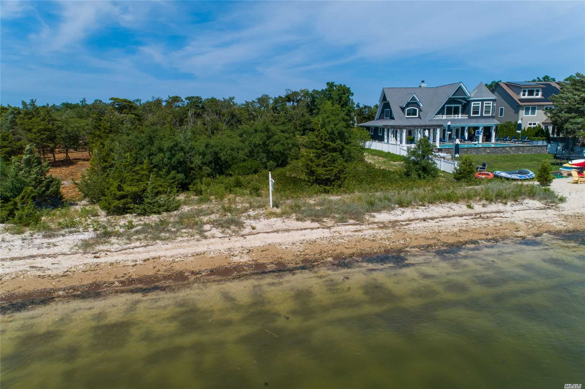 One of the Most Beautiful Beaches on The North shore. The Hampton Life is Right Here. Waterfront Parcel One Acre. Gorgeous Beach Front, Mooring and Beach.Quiet and Peaceful Quintessential Beach Life in Asharoken . Private Village and Police. Enjoy the Ambiance of Northport Village. Plans are Available Upon Request. SD#4