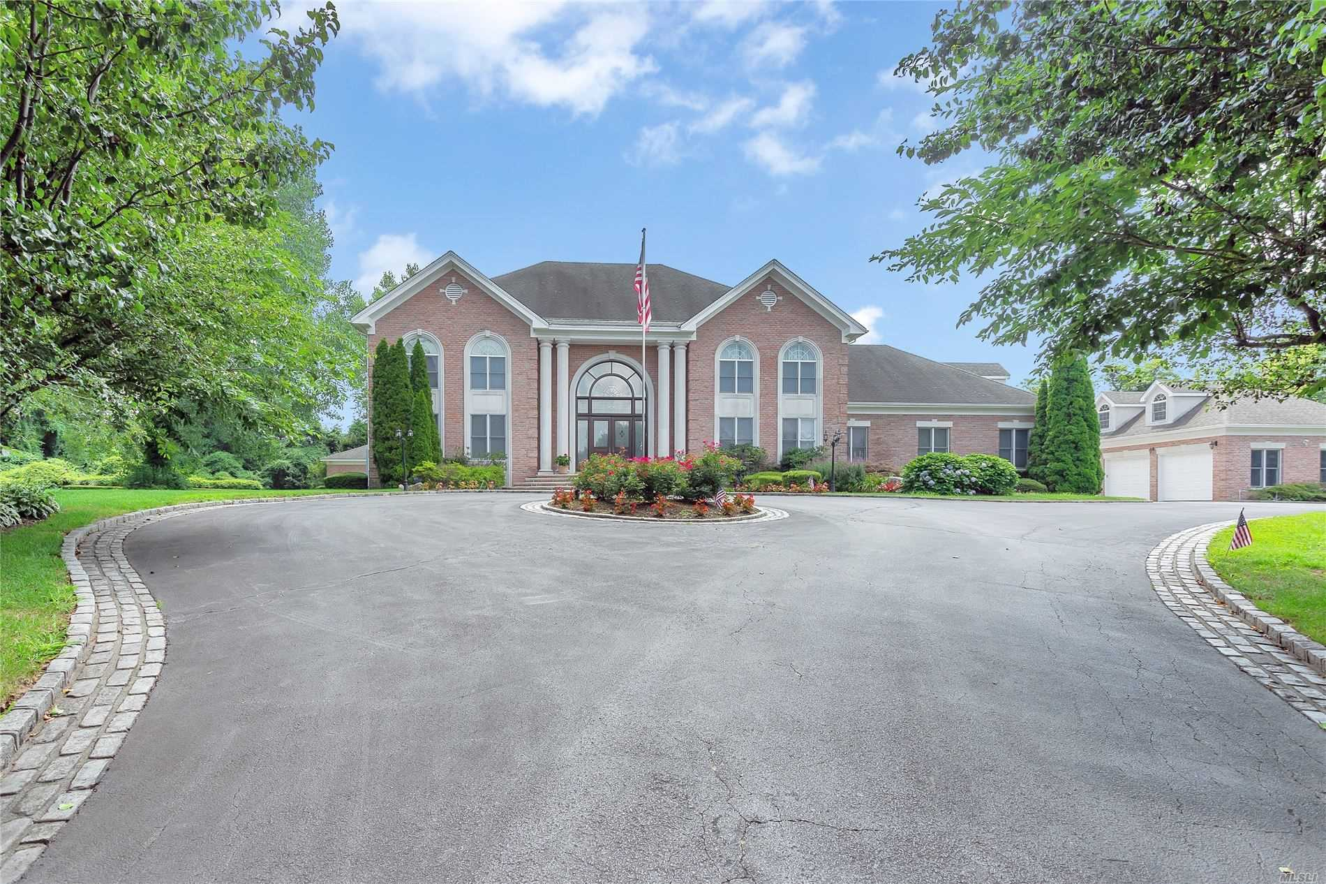 Upper Brookville. Grand Brick Georgian Manor On Private Cul-De-Sac Location In Upper Brookville. This Stately Custom-Built Home On Over 2 Serene Acres Features 5 Bedrooms & 4.5 Baths. With Bright & Airy Rooms Throughout, Grand Entry Foyer W/2nd Floor Balconies, Dining Room, Large & Open Living Room & Den, Family Room W/Custom Bar & Built Ins, Eat in Kitchen & Exquisite Breakfast Area W/Double Sided Fireplace & Multiple French Doors to Patio, 3 Car Att. & 3 Car Det. Garages, Ig Pool & Poolhouse.