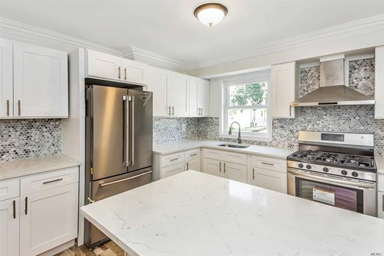 Legal 2 Family Home, Fully Renovated, 2 New Granite kitchen, with brand new appliances, floors, cabinets. New floors throughout, new base and crown molding, 2 New bathroom, New Doors, all new windows, High hats throughout All freshly painted. All new fence. Huge Garage 1.5 car. Award Winning Lynbrook School District. 5 Min Walk to Lirr, 35-40 Min ride to NYC. Wont last! Market rent upstairs est $1800. Too much to list. VERY AFFORDABLE.