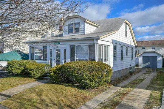 Located Across from The Canal, Lovely 4 Bedroom, 2 New Full Baths Waterfront Cape Features Living Room W/Fireplace, Updated Eik, Formal Dining Room, Enclosed Porch With Views Of The Canal, Eik, Basement, 1 Car Garage With Extra Long Driveway, Private Backyard, And More! Low Taxes! Prime Wantagh School District. Moments To Lirr. Flood Insurance is $1, 800/year up to $150k.